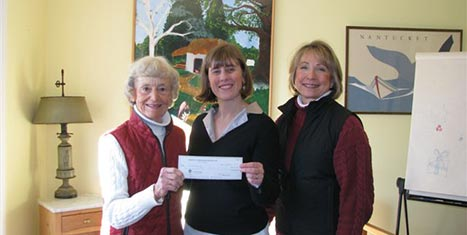 CFNan Chairman Peggy Gifford awards the grant to A Safe Place Executive Director Kat Grieder and Board Chair Michelle Langois