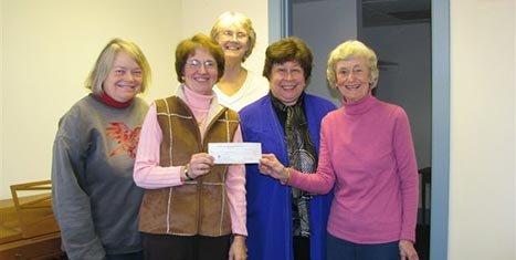 CFNan Board Chairman presents a grant check to Rental Assistance Administrator Janis Carreiro and Board members Terry Anne Vigil, Rev. Georgia Snell and Rev. Jennifer Brooks.