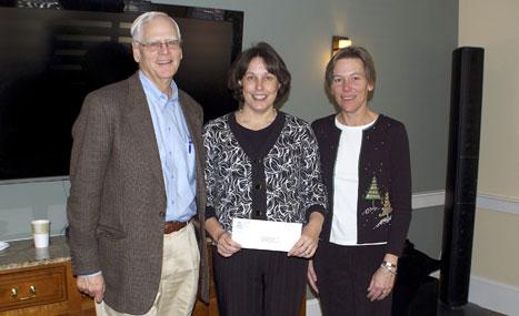 CFNan President Phil Stambaugh and ED Margaretta Andrews present a grant to Linda Robert, Director of Nantucket Center for Elder Affairs.