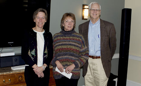 Nantucket Ice ED Lynn Fiedler accepts a grant from Phil Stambaugh, President CFNan and ED Margaretta Andrews
