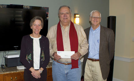 Steve McCluskey, ED of Small Friends on Nantucket, accepts a grant check from CFNan ED, Margaretta Andrews and President Phil Stambaugh