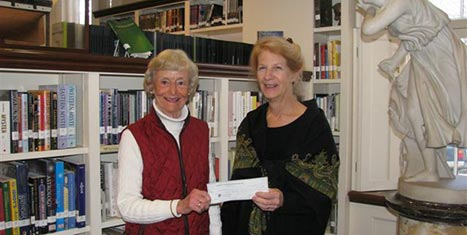 Molly Anderson, ED of the Atheneum, accepts a grant check from CFNan Board Chairman, Peggy Gifford.