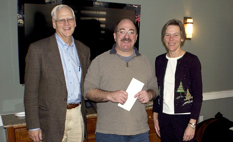 Big Brothers Big Sisters Program Director David Zieff accepts a grant from Phil Stambaugh, President CFNan and ED Margaretta Andrews.