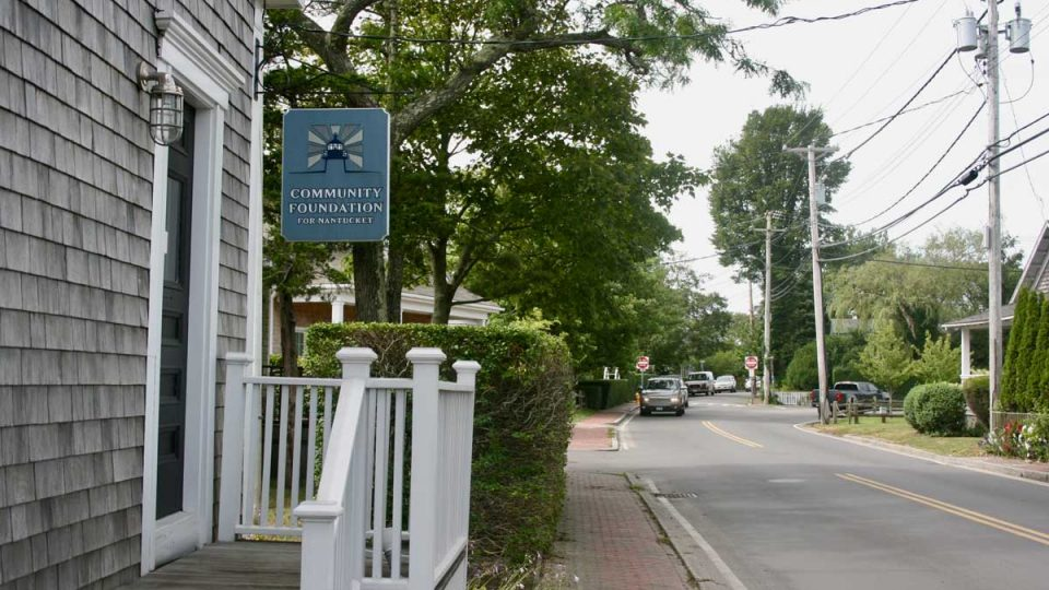 Community Foundation for Nantucket sign hangin in front of building.