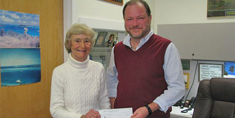 NCH Social Services Manager Peter MacKay receives a grant check from CFNan's Board Chairman, Peggy Gifford.