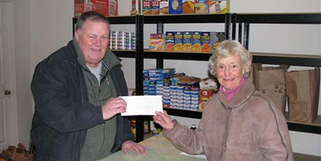 Peggy Gifford, CFNan Board Chairman, hands a grant check to Kevin Dugan, ED for the Nantucket Emergency Food Pantry.