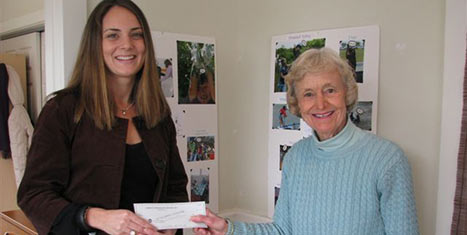 Kristin Worgess, ED of S.T.A.R. receives a grant check from Peggy Gifford, Board Chairman CFNan.
