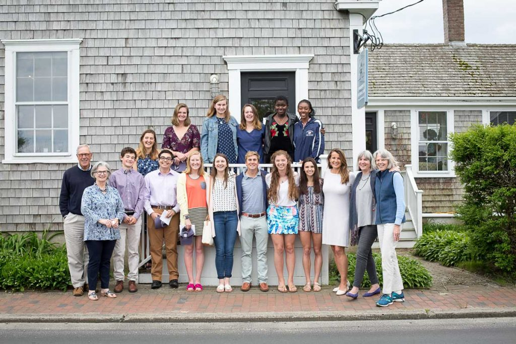 Group of 18 young adults standing on stairs.