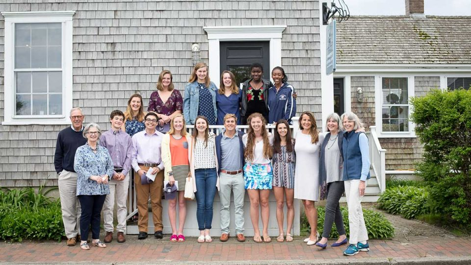 Group of 18 youn scholarship winners on standing on stairs.